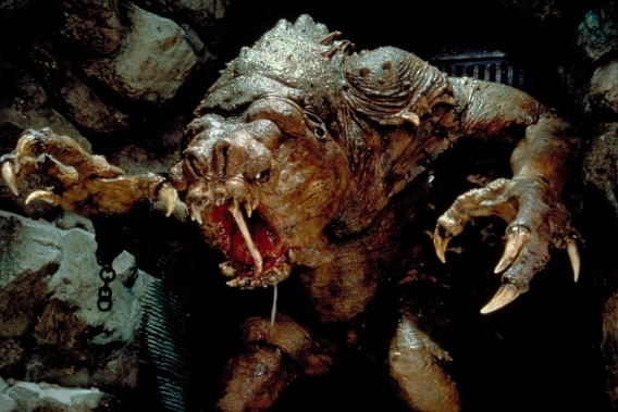 I can't help but see the Watcher's similarity with the Rancor in Jabba the Hut's palace.